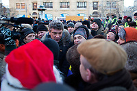 Opposition leader and former deputy prime minister Boris Nemtsov speaks with protesters in Lubyanka Square during an unsanctioned anti-Putin demonstration in Moscow, Russia.  Police arrested a number of protesters and opposition leaders.