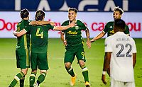 CARSON, CA - OCTOBER 07: Jorge Villafana #4, Diego Valeri #8 and Felipe Mora #9 of the Portland Timbers celebrate a Portland goal during a game between Portland Timbers and Los Angeles Galaxy at Dignity Heath Sports Park on October 07, 2020 in Carson, California.