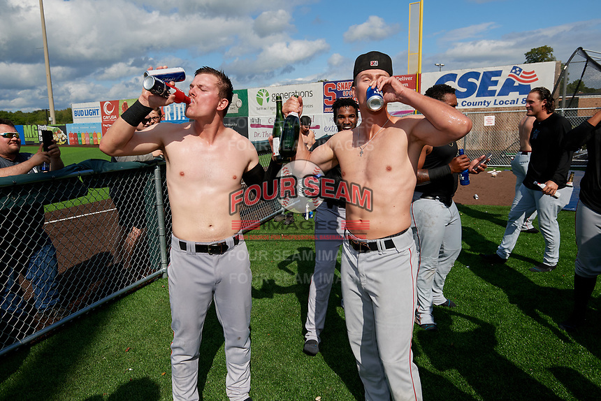 Batavia Muckdogs Troy Johnston (left) and Jack Strunc (right) celebrate after clinching the Pinckney Division Title during a NY-Penn League game against the Auburn Doubledays on September 2, 2019 at Falcon Park in Auburn, New York.  Batavia defeated Auburn 7-0 to clinch the Pinckney Division Title.  (Mike Janes/Four Seam Images)