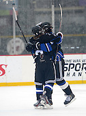 Brockport Blue Devils Koby Dusett (6) and Kirby Trask (15) celebrate a goal during a varsity ice hockey game against the Notre Dame Fighting Irish of Batavia during the Section V Rivalry portion of the Frozen Frontier outdoor hockey event at Frontier Field on December 22, 2013 in Rochester, New York.  (Copyright Mike Janes Photography)