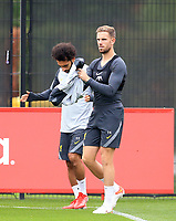 14th September 2021: The  AXA Training Centre, Kirkby, Knowsley, Merseyside, England: Liverpool FC training ahead of Champions League game versus AC Milan on 15th September: Jordan Henderson of Liverpool puts on his training jacket