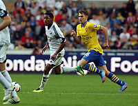 Saturday 28 September 2013<br /> Pictured L-R: Jonathan de Guzman of Swansea against Aaron Ramseyi of Arsenal<br /> Re: Barclay's Premier League, Swansea City FC v Arsenal at the Liberty Stadium, south Wales.