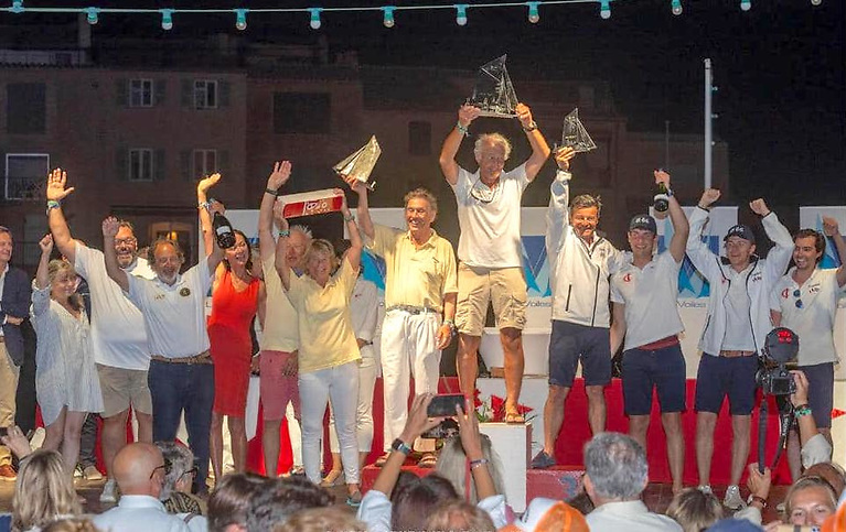 Cork helmsman Harold Cudmore lifts the trophy in St. Tropez after winning Le Voile Saint Tropez Classic Regatta on the restored Cork Harbour one Design, Jap. RCYC Admiral Colin Morehead is pictured third from left