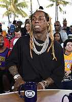 """MIAMI BEACH, FL - JANUARY 31: Lil Wayne on the set of """"Skip & Shannon: Undisputed"""" on the Fox Sports South Beach studio during Super Bowl LIV week on January 31, 2020 in Miami Beach, Florida. (Photo by Frank Micelotta/Fox Sports/PictureGroup)"""