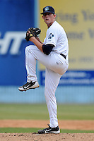 Asheville Tourists starting pitcher Daniel Winkler #15 delivers a pitch during a game against the Lexington Legends at McCormick Field on May 6, 2012 in Asheville, North Carolina . The Tourists defeated the Legends 8-5. (Tony Farlow/Four Seam Images).