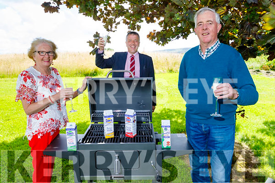 Jane and Pat Casey (front) from Cromane, winners of the Dawn Milk Alfresco Dining Summer promotion, presented to then by Declan Sheehan on Thursday.
