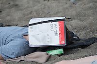 Aberystwyth Wales UK, Thursday 12 May 2016<br /> UK Weather: A man is sunbathing on the beach with his face covered by an A4 refill pad, at the seaside in  Aberystwyth, on the Cardigan Bay coast of west Wales, enjoying a last day of warm weather in the current mini-heatwave. <br /> The temperatures are set to fall over the coming days, with bright but colder conditions prevailing over the country