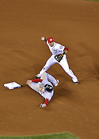12 October 2012: Washington Nationals shortstop Ian Desmond gets a sliding David Freese out at second in the 6th inning of Postseason Playoff Game 5 of the National League Divisional Series against the St. Louis Cardinals at Nationals Park in Washington, DC. The Cardinals stunned the home team with a four-run rally in the 9th inning to defeat the Nationals 9-7 and win the NLDS, moving on to the NL Championship Series. Mandatory Credit: Ed Wolfstein Photo
