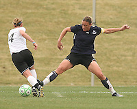 Abby Wambach (blue) of the Washington Freedom stretches out to stop Jen Buczkowski  of Sky Blue F.C. during a WPS pre season match at Maryland Soccerplex, in Boyd's, Maryland on March 14 2009. Sky Blue won the match 1-0