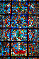 Medieval stained glass Window of the Gothic Cathedral of Chartres, France - dedicated to The Tree of Jesse (12th century). Botton row of panels - Nahum / Jesse with the 'stem' growing from his loins / Joel. row above - Ezekiel / David / Hosea, row above - saiah / Solomon / Micah. Top row - Moses / Generic King of Israel / Balaam. A UNESCO World Heritage Site.