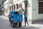 A sanitationworker collects garbage from lane in Kalighat area in Kolkata, West Bengal, India. Arindam Mukherjee.