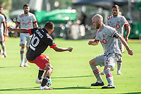LAKE BUENA VISTA, FL - JULY 13: Edison Flores #10 of DC United and Michael Bradley #4 of Toronto FC battle for the ball during a game between D.C. United and Toronto FC at Wide World of Sports on July 13, 2020 in Lake Buena Vista, Florida.