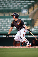 GCL Orioles first baseman Ian Evans (26) hits a single during the first game of a doubleheader against the GCL Twins on August 1, 2018 at CenturyLink Sports Complex Fields in Fort Myers, Florida.  GCL Twins defeated GCL Orioles 7-6 in the completion of a suspended game originally started on July 31st, 2018.  (Mike Janes/Four Seam Images)