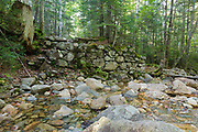 Old bridge abutment at the Redrock Brook crossing along the Franconia Branch (today's Franconia Brook Trail) of the old East Branch & Lincoln Railroad (1893-1948) in the Pemigewasset Wilderness of New Hampshire. Tropical Storm Irene damaged this abutment in 2001, and it no longer looks this way.