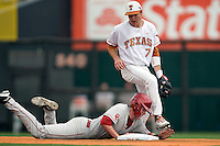 Firstbaseman Cameron Seitzer #33 of the Oklahoma Sooners dives back to second base as Texas Longhorn Jordan Eiter #7 watches in NCAA Big XII baseball on May 1, 2011 at Disch Falk Field in Austin, Texas. (Photo by Andrew Woolley / Four Seam Images)