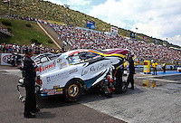 Jul. 20, 2014; Morrison, CO, USA; Crew members with NHRA funny car driver Tim Wilkerson during the Mile High Nationals at Bandimere Speedway. Mandatory Credit: Mark J. Rebilas-