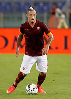 Calcio, amichevole Roma vs Fenerbahce. Roma, stadio Olimpico, 19 agosto 2014.<br /> Roma midfielder Radja Nainggolan, of Belgium, in action during the friendly match between AS Roma and Fenerbache at Rome's Olympic stadium, 19 August 2014.<br /> UPDATE IMAGES PRESS/Riccardo De Luca
