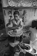 In Casablanca, Morocco, children are employed to engrave copper plate. Child labor as seen around the world between 1979 and 1980 – Photographer Jean Pierre Laffont, touched by the suffering of child workers, chronicled their plight in 12 countries over the course of one year.  Laffont was awarded The World Press Award and Madeline Ross Award among many others for his work.