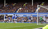 Pictured: Chico Flores of Swansea (R in white) jumps to get a header from a team mate's cross. Saturday 22 March 2014<br /> Re: Barclay's Premier League, Everton v Swansea City FC at Goodison Park, Liverpool, UK.