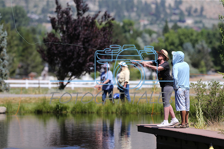 Jose Luna watches as breast cancer survivor Karen Kernan, of Reno, learn to fly-fish during a Casting for Recovery retreat in Gardnerville, Nev., on Friday, June 30, 2017. The nationwide program, hosted locally with Carson Tahoe Cancer Center, pairs cancer survivors with fly-fishing guides.   <br /> Photo by Cathleen Allison/Nevada Photo Source