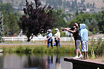 Jose Luna watches as breast cancer survivor Karen Kernan, of Reno, learn to fly-fish during a Casting for Recovery retreat in Gardnerville, Nev., on Friday, June 30, 2017. The nationwide program, hosted locally with Carson Tahoe Cancer Center, pairs cancer survivors with fly-fishing guides.   <br />