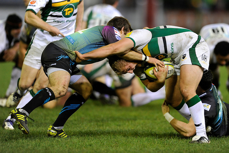 Mike Haywood of Northampton Saints (right) drives into Tom Grabham of Ospreys during the LV= Cup second round match between Ospreys and Northampton Saints at Riverside Hardware Brewery Field, Bridgend (Photo by Rob Munro)