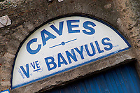 Caves Veuve Banyuls, wine cellar sign in blue. Collioure. Roussillon. The wine shop and tasting room. France. Europe.