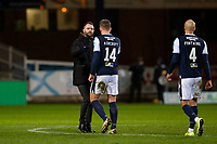 27th March 2021; Dens Park, Dundee, Scotland; Scottish Championship Football, Dundee FC versus Dunfermline; Dundee manager James McPake shakes hands with Lee Ashcroft who scored the winning goal