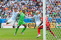Marcos Rojo of Argentina heads the ball at goal