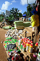 BURKINA FASO, Gaoua, market, sale of pesticides, fertilizer, seeds / Marktstand mit Pestiziden, Herbiziden, Dünger, Saatgut