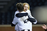 William Simoneit (rear) hugs teammate Shane Smith (21) after hitting a walk-off solo home run in the bottom of the ninth inning against the Louisville Cardinals at David F. Couch Ballpark on March 7, 2020 in  Winston-Salem, North Carolina. The Demon Deacons defeated the Cardinals 3-2. (Brian Westerholt/Four Seam Images)