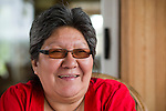 "Clara Bouchier from Fort McKay laughs. Clara and her husband, Andrew, have seen many changes in the Fort McKay region, especially when it comes to hunting and animals. For many years, Andrew was a hunter, but it costs too much money now. ""Whereever you go out here, all you see is gates, gates all over."""
