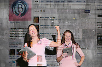 NO Repro Fee.27/10/2010.  Ballygowan Pink's B Part Of It campaign in support of Breast Cancer Awareness Month. Hundreds of UCD students got behind Ballygowan Pink's B Part Of It campaign in support of Breast Cancer Awareness Month. Pictured areRegina Brady from Longford and Sinead McAuliffe from Dublin who posted messages of support to the life-sized Facebook Wall which was projected onto the entrance of UCD library. A live stream of students' messages was seen throughout the day to raise awareness of breast cancer and support the Marie Keating Foundation. Picture James Horan/Collins Photos