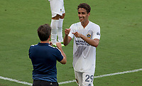 LOS ANGELES, CA - AUGUST 22: Ethan Zubak #29 of the LA Galaxy is greeted by head coach Guillermo Barros Schelotto as he departs the field of play during a game between Los Angeles Galaxy and Los Angeles FC at Banc of California Stadium on August 22, 2020 in Los Angeles, California.