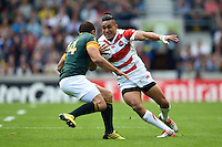 Male Sa'u of Japan in possession. Rugby World Cup Pool B match between South Africa and Japan on September 19, 2015 at the Brighton Community Stadium in Brighton, England. Photo by: Patrick Khachfe / Stewart Communications