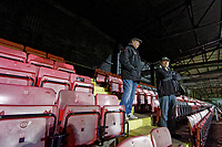 Pictured: Local supporters John Thomas (R) and Vincent Prout (L) watch training from the stand. Tuesday 20 February 2019<br /> Re: Neath RFC training at The Gnoll in Neath, south Wales, UK.