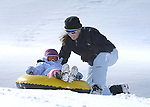 Mya, 4, and Margaret Schaffer, of Crested Butte, enjoy tubing at the Crested Butte Nordic Center's sledding hill. © Michael Brands. 970-379-1885.