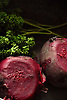 The beetroot is the taproot portion of the beet plant, also known in North America as the table beet, garden beet, red or golden beet, or informally simply as the beet. It is several of the cultivated varieties of beet (Beta vulgaris) grown for their edible taproots and their greens. <br /> <br /> Other than as a food, its uses include food coloring and as a medicinal plant. Many beet products are made from other Beta vulgaris varieties, particularly sugar beet.<br /> <br /> Beetroot can be peeled, steamed, and then eaten warm with butter as a delicacy; cooked, pickled, and then eaten cold as a condiment; or peeled, shredded raw, and then eaten as a salad. Pickled beets are a traditional food of the American South, and are often served on a hamburger in Australia, New Zealand, and the United Arab Emirates.<br /> <br /> Parsley is widely used in Middle Eastern, European, Brazilian and American cooking. Curly leaf parsley is used often as a garnish. Green parsley is used frequently as a garnish on potato dishes (boiled or mashed potatoes), on rice dishes (risotto or pilau), on fish, fried chicken, lamb, goose, and steaks, as well in meat or vegetable stews (including shrimp creole, beef bourguignon, goulash, or chicken paprikash).<br /> <br /> Stock Photo by Paddy Bergin