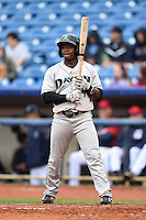 Dayton Dragons second baseman Jamodrick McGruder (4) at bat during a game against the Lake County Captains on June 8, 2014 at Classic Park in Eastlake, Ohio.  Lake County defeated Dayton 4-2.  (Mike Janes/Four Seam Images)