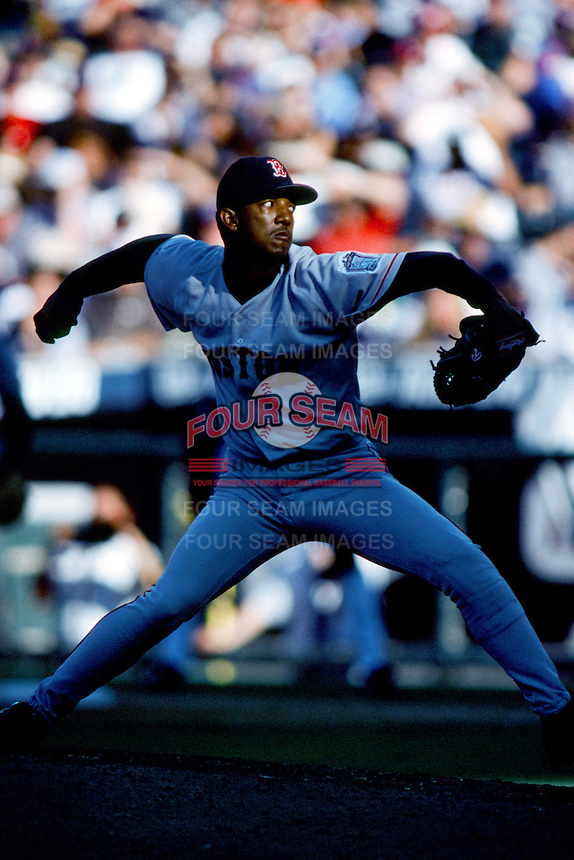Pedro Martinez of the Boston Red Sox pitches during a 1999 Major League Baseball season game against the Anaheim Angels in Anaheim, California. (Larry Goren/Four Seam Images)