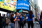 Coinbase Global Inc. employees drink champagne during the company's initial public offering (IPO) outside of the Nasdaq MarketSite in New York, U.S., on Wednesday, April 14, 2021. Photograph by Michael Nagle