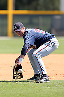 Atlanta Braves first baseman Brandon Drury #26 during warmups before an Instructional League game against the Pittsburgh Pirates at Pirate City on October 14, 2011 in Bradenton, Florida.  (Mike Janes/Four Seam Images)