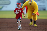 LeRoy little leaguer wins the base race during a Batavia Muckdogs game against the Auburn Doubledays at Dwyer Stadium on June 17, 2011 in Batavia, New York.  Auburn defeated Batavia in the season opener 6-1.  (Mike Janes/Four Seam Images)