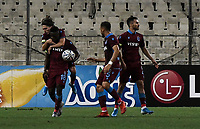 Trabzonspor's Caleb Ekuban (18) celebrate with his team players his goal during of the UEFA Europa League play-off, 1st leg, soccer match between AEK Athens FC and Trabzonspor at the OAKA Spyros Louis Stadium in Athens, Greece on August 22, 2019.