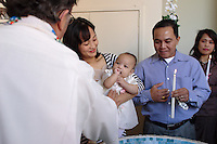 Montreal (Qc) CANADA , October 2007 -<br /> Model Released photo -<br /> A Filipina baby girl get baptised in a Catholic church in Montreal.<br /> photo : (c) Pierre Roussel - images Distribution