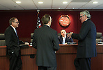 Gaming Control Board Chairman Mark Lipparelli, center, listens to former chairman Dennis Neilander, far left, Deputy Attorney General Michael Somps and attorney Mark Clayton discuss online gaming during a meeting in Carson City, Nev., on Wednesday, Dec. 7, 2011. .Photo by Cathleen Allison