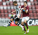 ST MIRREN'S GRAHAM CAREY AND HEARTS' RYAN MCGOWAN CHALLENGE FOR THE BALL