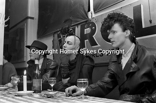 Blitz Kids New Romantics at The Blitz Club Covent Garden, London, England 1980.<br /> Michele Clapton, award winning costume designer 'Game of Thrones, with (on left in hat) <br /> anyone know his name please. Graham Smith (photographer)?<br /> <br /> Names  thanks to Iain R Webb