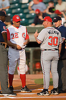 Chattanooga Manager Jayhawk Owens (32) and Mississippi Manager Phillip Wellman (30) go over the ground rules at AT&T Field in Chattanooga, TN, Wednesday, July 26, 2007.