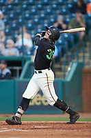 Mason Martin (35) of the Ocelotes de Greensboro follows through on his swing against the Hickory Crawdads at First National Bank Field on June 11, 2019 in Greensboro, North Carolina. The Crawdads defeated the Ocelotes 2-1. (Brian Westerholt/Four Seam Images)